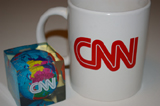 CNN mug and world paperweight