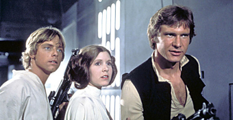 Carrie Fisher in Star Wars with Mark Hamill and Harrison Ford