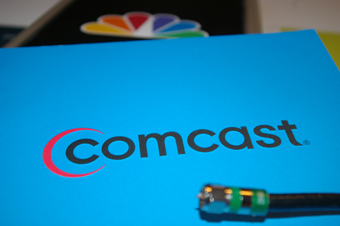 Comcast logo with cable