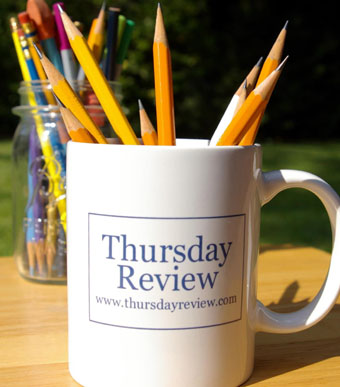 Thursday Review coffee mug with pencils in it