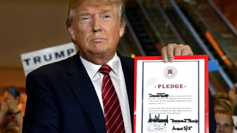 Donald Trump signs GOP pledge