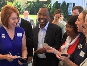 Dr. Ben Carson with Vanita Boulware Sansom (left) and others at a campaign event in Montgomery, AL
