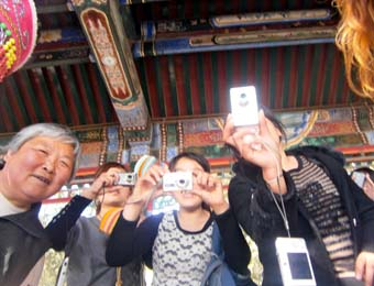 Chinese taking photos of Michael Bush & family